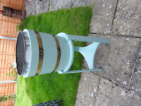 Wooden planter with zinc liner and stand.