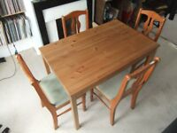 Solid pine dining room table and four chairs