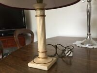 Porcelain colm lamp with 15 inch red shade with gold bands 19 inches tall