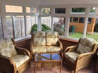 Wicker conservatory furniture 2 seater settee & 2 chairs & a table