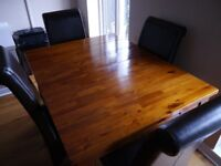Handcrafted solid wood dining table and 4 brown leather chairs