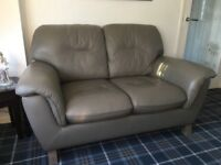 Leather Grey two seater and two swivel chair suite