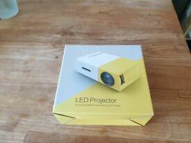 Mini Projector Artlii Portable Projector Pico Pocket Projector 60,000 Hrs Led Projector Chargeable