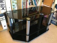 A smoked glass TV stand in excellent condition