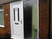 Upvc front door with double glazed side panel