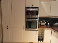 Cream Shaker style kitchen and work tops in range of sizes and Iroko wood work tops.