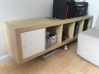 Low level storage cabinet