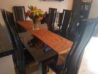 Black glass extending dining table with 6 chairs
