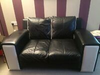 Two 2 seater leather sofas plus 1 foot stool