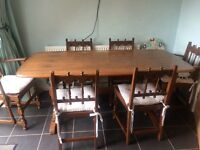 Solid wood Ercol dining table and chairs