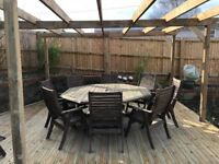 Eight seater octagonal garden table with matching chairs