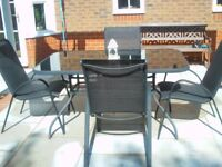 Glass top patio table with six chairs