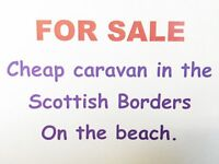 For sale. Static caravan holiday home by the sea. Quiet park on the beach. Berwickshire coast.