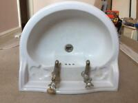 White bathroom sink and pedestal (brass taps)