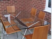 Glass top dining table and 6 chairs, ex, cond, can deliver