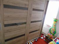 Big solid wardrobe with sliding doors