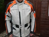 BF Waterproof Jacket. Shoulder and arm protection, in excellent condition. Size XXL