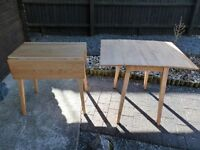 Solid wooden folding dining table with 2 extendble flaps. Ideafor smaller spaces. Nearly New