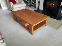 Next coffee table with double sided draw