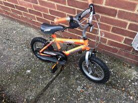 """Kids 10"""" orange bike"""