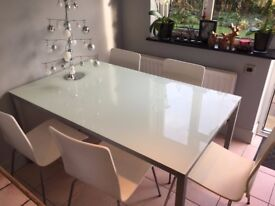 Glass Topped Dining Table with 5 white chairs