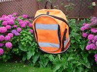 fluorescent orange back pack.