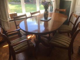 Dining table and chairs and cabinet