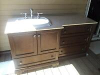 vanity with marble top and faucet