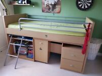 Bunk bed with pullout desk and storage