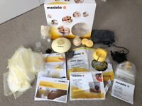 Medela Swing Breast Pump with Calma, used once, and Medela extras