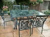 Glass top patio table and 6 chairs