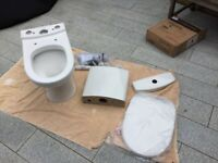 Modern cloakroom toilet, brand new in box