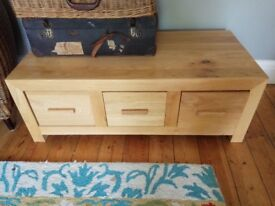 Lovely low oak unit. Incredibly heavy and sturdy