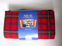 Checked pic nick rug with PVCwaterproof backing and carry handle. New