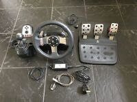 Logitech G27 steering wheel with optional accessories