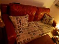 Red leather sofa and chair suite