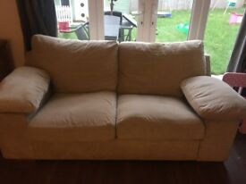Three seater and two seater material beige sofas