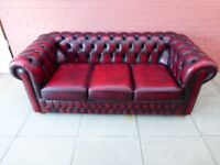 A Saxon Oxblood Red Leather Chesterfield Three Seater Sofa