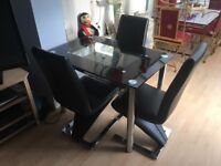 Dining table & chairs - very stylish expensive set