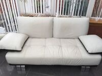 Fantastic off white and black leather two seater with two swivel chairs and storage box must see
