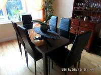 Modern Black Glass Table & 6 Black Faux Leather Chairs
