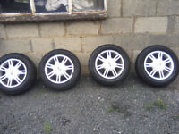 TYRES 175 X 65 X 14 ON FORD FIESTA ALLOYS. ALL 4 WITH EXCELLENT TREAD.