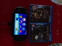 Playstation Vita + Two Games + 8gb memory card