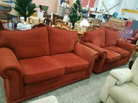 Light red fabric twin two seater sofa suite
