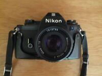 Nikon EM / SLR Camera plus lenses