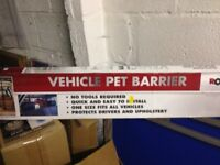 dog/ pet barrier, new in box , fits most cars