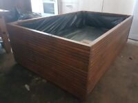 2 planter boxes. Brand new. 30in wide 4ft long. Stained.