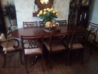 EXTENDING MAHOGANY DINING TABLE SEATS 8, TWO PEDESTALS WITH BRASS CLAW FEET. IN EXCELLENT CONDITION.
