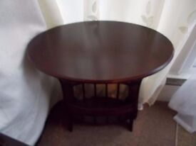 Dark small table with magazine rack