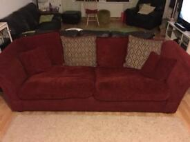 Large deep red 4 seater sofa